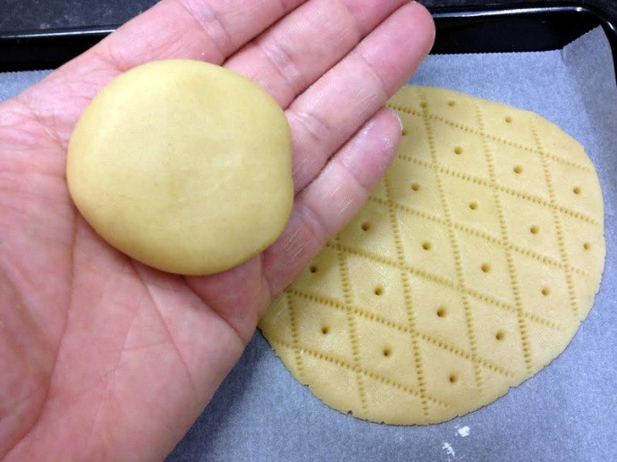 Making Shrewsbury Cakes. The cakes are patted out and then patterned with a comb.